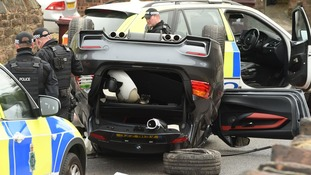 Police around the car in Huyton.