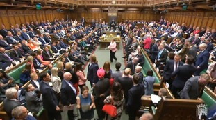 SNP MPs walk out of the House of Commons during Prime Minister's Questions.