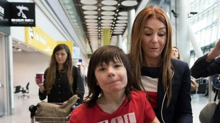Charlotte Caldwell and her son Billy at Heathrow Airport