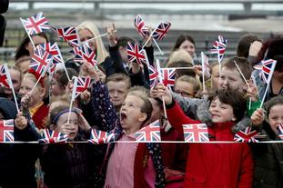 School children waited eagerly to greet the royals.