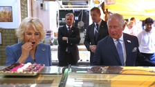 Prince Charles and Camilla sample some of the goods on offer at Cork's famous English Market.