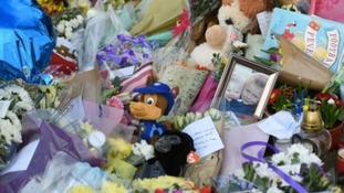 Toys and flowers were left near the scene of the crash for brothers Corey and Casper.