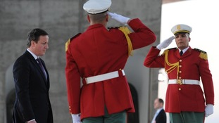 David Cameron visits the Monument des Martyrs on his arrival in Algiers, Algeria