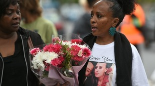 A mourner, who lost her sister in the fire.