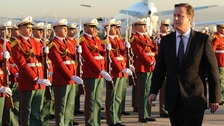 David Cameron visits the Monument des Martyrs on his arrival in Algiers, Algeria, with Algerian Energy Minister Yousfi