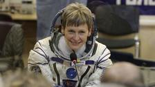 US astronaut Peggy Whitson has retired after 665 days in space.