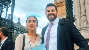 Upskirting victim and campaigner Gina Martin with lawyer Ryan Whelan outside the Houses of Parliament