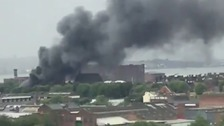 Blaze at former school site sends smoke plume across city