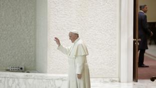 Pope Francis leaves after an audience at the Vatican.