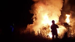 Flames engulf a car near the A52