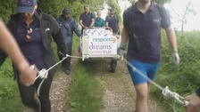 Medical staff conquer South Downs Way pushing hospital bed