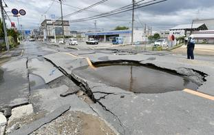 Huge cracks in roads were caused by the quake.