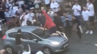 The England fan was thrown off the bonnet of a car while celebrating the team's win