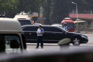 A stretch limo without state flags leaves a Beijing airport