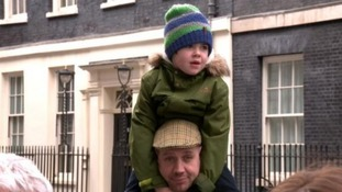 Alfie and his father outside Downing Street.