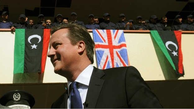 David Cameron meets recruits at a police training college in Tripoli