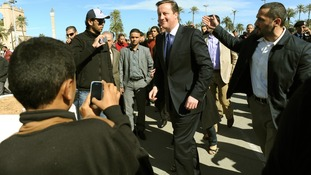 David Cameron walks through Martyrs Square in Tripoli