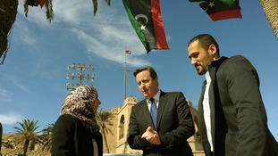 David Cameron takes a walk through Martyrs Square in Tripoli