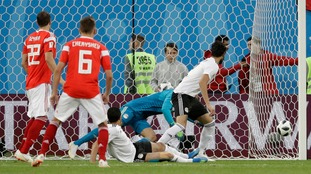 Rampant Russia all-but seal place in World Cup knockout stages