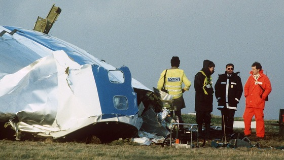December 1988: Rescue workers and investigators search the area around the cockpit of Pan Am flight 103
