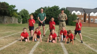 pic of runners and pupils