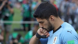 Luis Suarez sends Uruguay through with a goal on his 100th appearance