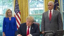 Trump signs order overturning family separation policy