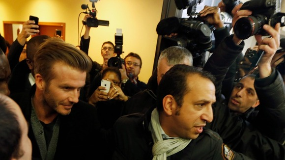 David Beckham surrounded by bodyguards at the Pitie-Salpetriere hospital