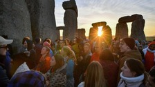 Solstice-watchers celebrate sunrise at Stonehenge