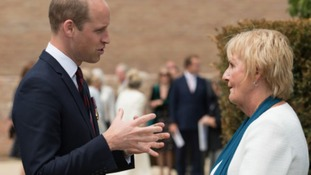 Prince William speaks to a competition winner
