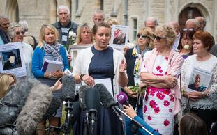 Bridget Reeves the granddaugher of Elsie Devine who died at Gosport War Memorial Hospital, and her mother Ann (second from right) speak to the media after the disclosure of the Gosport report
