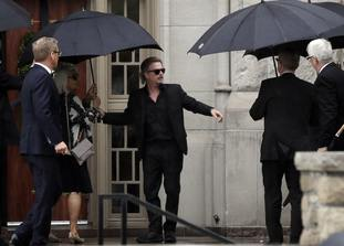 Actor-comedian David Spade helps family members enter the church