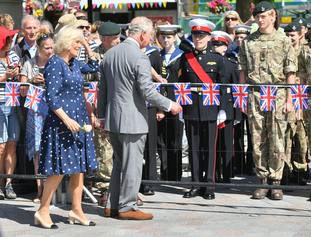 The Prince of Wales and Duchess of Cornwall met crowds outside the Guildhall