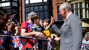 Prince Charles meets with royal fans in the city.