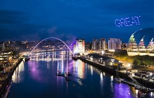 Drones spell out the word great as the Exhibition gets under way