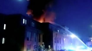 Flames could be seen shooting from the roof of the building