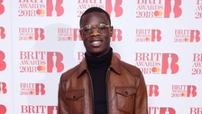 J Hus attending the Brit Awards 2018 Nominations.