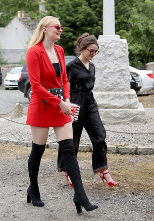 Actresses Sophie Turner 9left) and Maisie Williams arrive at the church