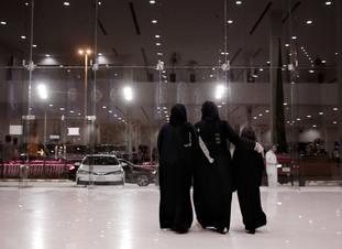 Women leave the Al-Jazirah Ford showroom in Riyadh, Saudi Arabia