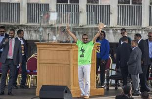 Ethiopia's Prime Minister Abiy Ahmed waves to the crowd at the rally