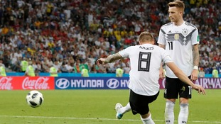 Marco Reus and a late Toni Kroos wonder-strike brought Germany back from the brink of an early World Cup exit