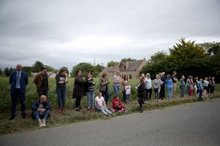 Members of the public wait opposite Rayne Church