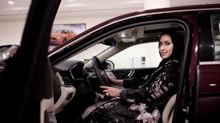 Car saleswoman Maram inside a Lincoln Continental at the Al-Jazirah Ford showroom in Riyadh.
