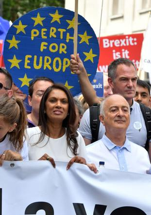 Pro-EU campaigner Gina Miller and Tony Robinson join with crowds gather on Pall Mall in central London, during the People's Vote march for a second EU referendum
