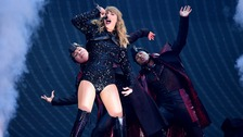 Taylor Swift performing on stage during the Reputation Stadium Tour at Wembley Stadium Olympic Way, Wembley, London.
