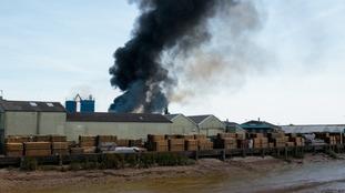 Fire crews battle wood yard blaze