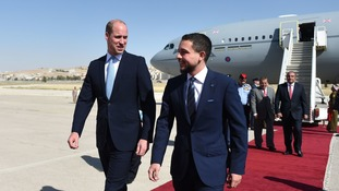 The Duke of Cambridge is met of the plane by the Crown Prince of Jordan.