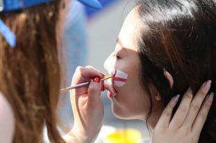 An England fan in Nizhny Novgorod had her face painted ahead of kick-off