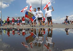 England fans show their support outside the stadium