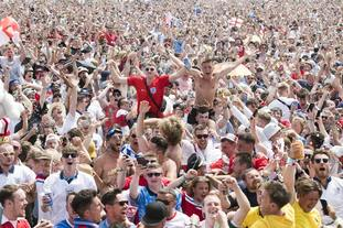 England supporters and festival goers celebrate the second goal at the Isle of Wight festival